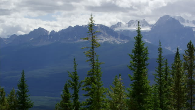 Pan along west Canadian Rockies during summer. Includes Mount Temple, Haddo Peak and Lake Louise and Mount Victoria