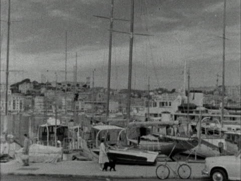 pan along yachts in the harbour at cannes. early 1960s - cote d'azur stock videos & royalty-free footage