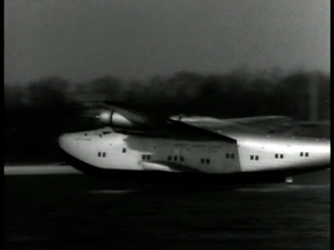 pan am clipper airplane taking off from water runway . twa airplane landing at airport united air line airplane fg porter placing steps below hatch... - 1939 stock-videos und b-roll-filmmaterial