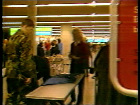 pan am takes legal action against cia; frankfurt airport seq people queuing at passport control and baggage through security check heathrow airport... - flughafen heathrow stock-videos und b-roll-filmmaterial