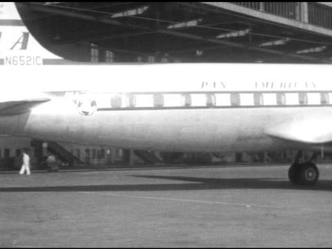 stockvideo's en b-roll-footage met pan american airline airplane taxiing at tempelhof airport moving out to runway passenger aircraft taking off down runway - koude oorlog