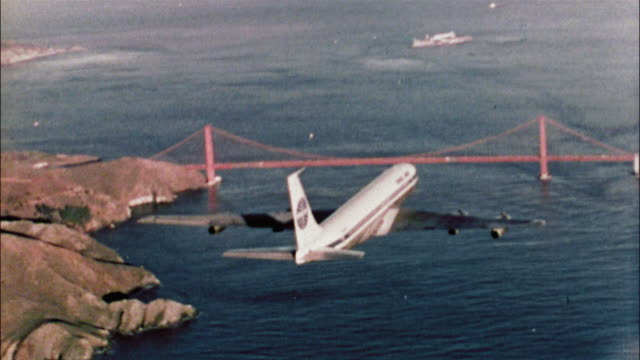 A Pan American Airways Boeing 707 flies above the Golden Gate Bridge in San Francisco Bay.