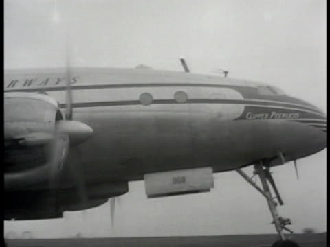 pan american 'constellation' passenger airplane on runway cu tail of plane ms turkish people pushing steps up to door of plane ha ws people gathered... - constellation stock videos and b-roll footage