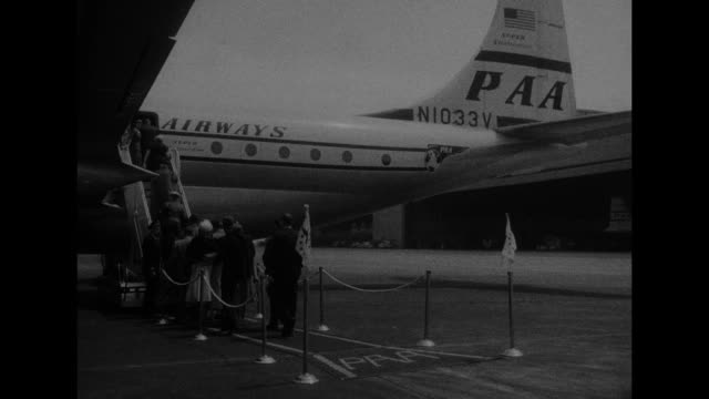 ms pan american world airways boeing 377 stratocruiser in air / vs passengers board stratocruiser at idlewild airport stewardess greets them / ms... - air stewardess stock videos & royalty-free footage