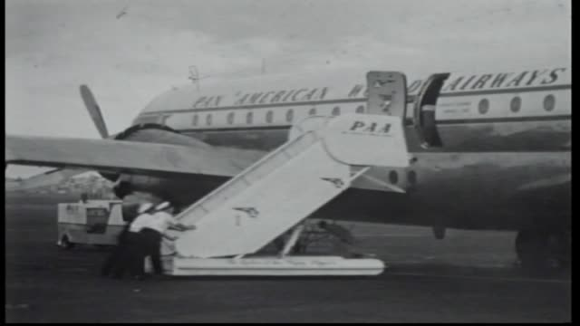 Pan American World Airways plane taxies / steps pushed up to plane