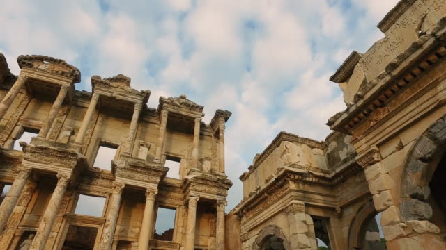 pan and tilt angle of ruin library roman style of ephesus turkey - artistic product stock videos & royalty-free footage