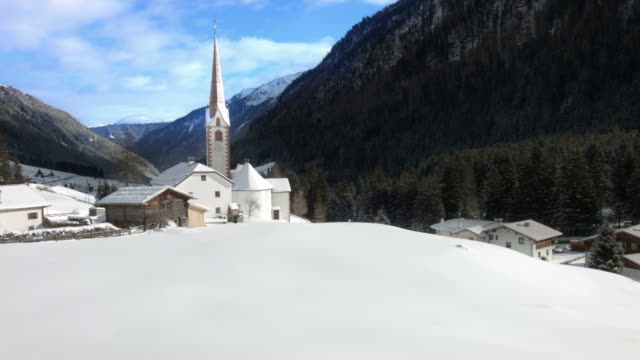 pan and tilt up: st. sigismund im sellrain, tyrol, austria, in winter - tyrol state austria stock videos and b-roll footage