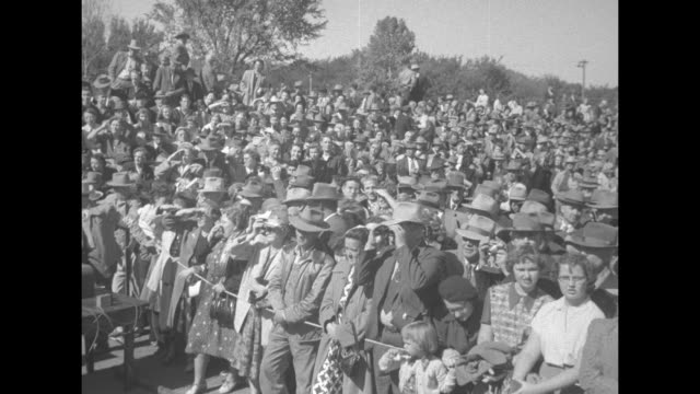 pan applauding crowd behind outdoor rope barricade at pres. harry truman campaign event for the democratic party / three women wearing glasses at... - barricade stock videos & royalty-free footage