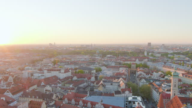 pan around city view with morning sun - rathaus stock videos & royalty-free footage