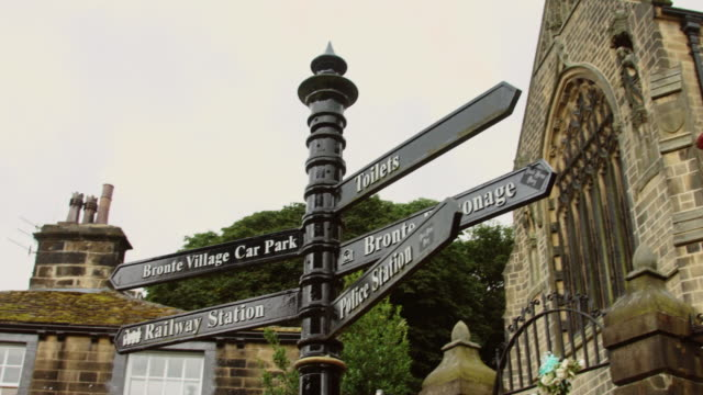 pan around haworth high street - telephone box stock videos & royalty-free footage