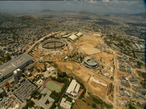 pan around oaka stadiums athens olympic sports complex in construction for 2004 olympic games - erezione video stock e b–roll
