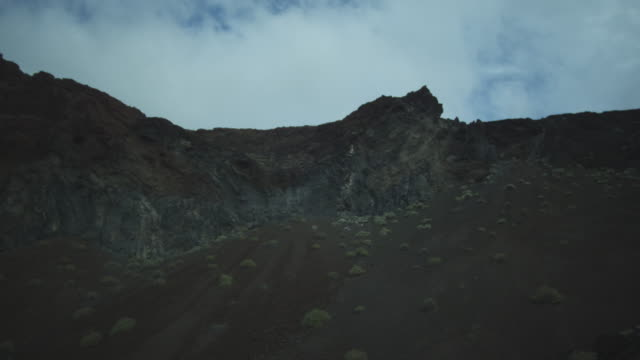pan around steep slope with rockfall, el hierro, canary islands, november 2011 - igneous stock videos and b-roll footage