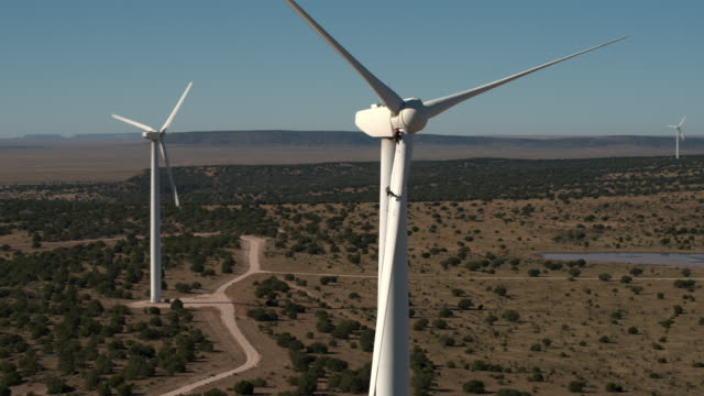 pan around turbine with workers - mill stock videos & royalty-free footage