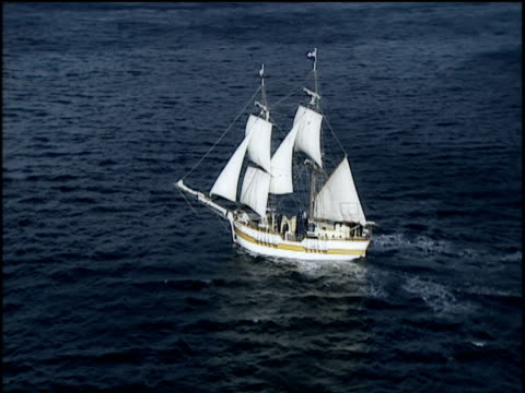 Pan around two masted Brig sailing off the coast of Tasmania