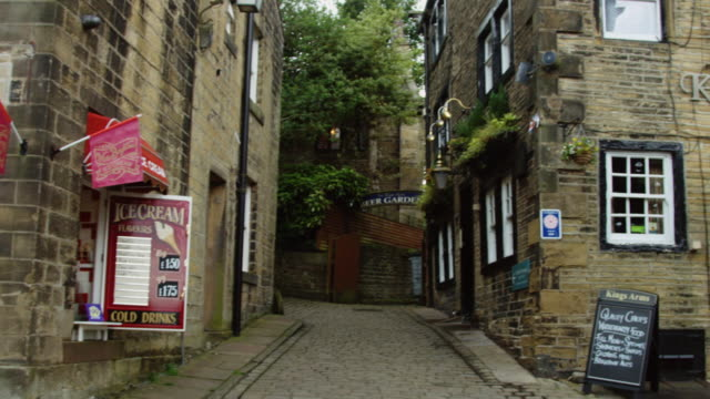 pan at top of haworth high street - yorkshire england stock videos & royalty-free footage