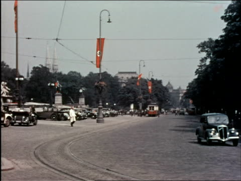 pan austrian parliament building, nazi flags lining the road beside it. - 1930 1939 stock videos & royalty-free footage