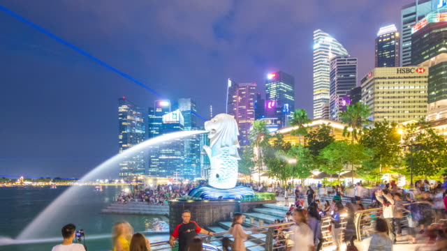pan away from tourists at merlion statue at night, singapore - merlion fictional character stock videos and b-roll footage