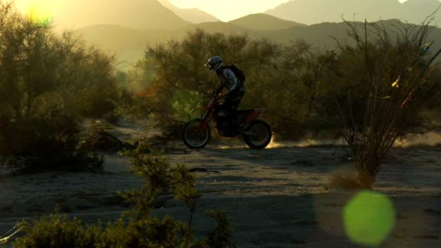 pan back lit motorbike - baja california peninsula stock videos and b-roll footage