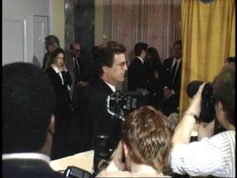 pan between ted danson and whoopi goldberg talking to reporters on red carpet - friars roast 1993 stock videos and b-roll footage