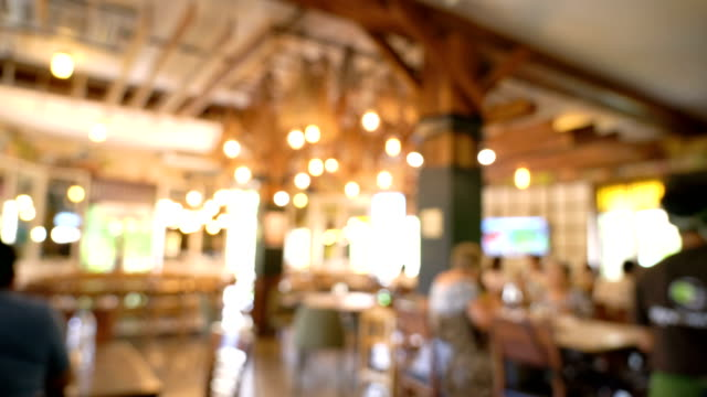 pan blurred, people in modern restaurant. - ristorante video stock e b–roll