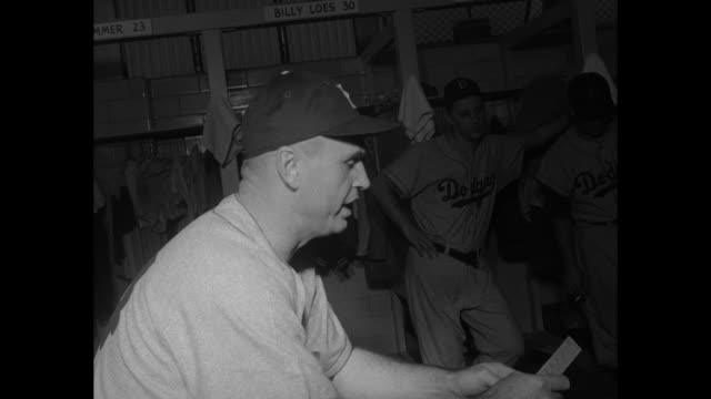 pan brooklyn dodgers in dressing room of county stadium in milwaukee where they face the milwaukee braves rear shot team manager walter alston... - atlanta braves stock-videos und b-roll-filmmaterial