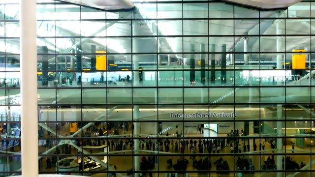 pan camera london departure & arrival, movement of passengers at airport - heathrow airport stock videos and b-roll footage