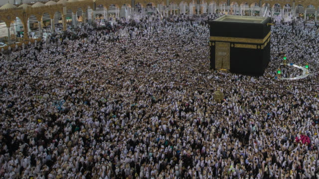 pan camera muslim praying - mecca stock videos and b-roll footage