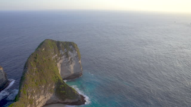 pan camera shot of amazing viewpoint kelingking beach nusa penida island at bali, indonesia - island stock videos & royalty-free footage