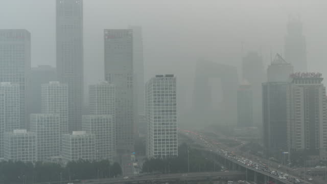 t/l ha lr pan cityscape of beijing in air pollution - beijing stock videos & royalty-free footage