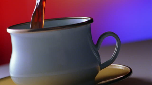pan close up coffee pouring into coffee cup and spilling over onto saucer - saucer stock videos and b-roll footage