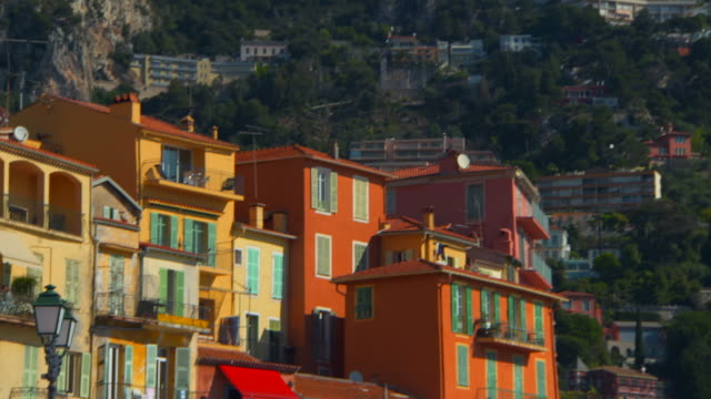 pan: colorful apartment building - cote d'azur stock videos & royalty-free footage