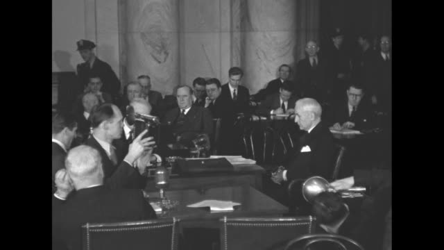 vídeos de stock e filmes b-roll de ws pan committee members to secretary of state cordell hull sitting alone at witness table / ws meeting / pan members to hull // new york city... - congresso organizações