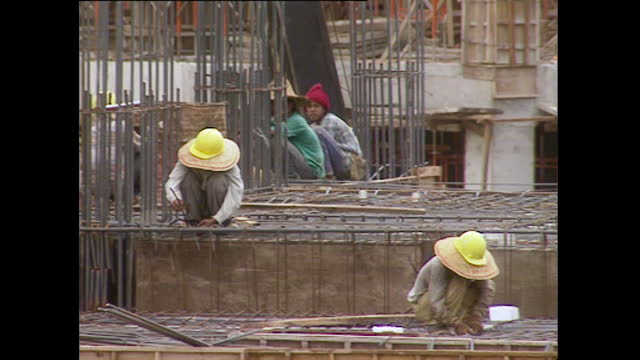pan construction workers on a building site in kuala lumpur; 1996 - 1996 stock videos & royalty-free footage
