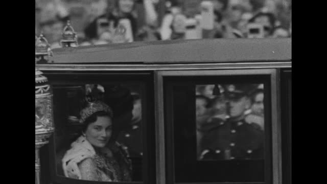 pan crowds in stands near westminster abbey which were constructed specially for george vi's coronation / queen mary and princesses margaret and... - george vi of the united kingdom stock videos & royalty-free footage