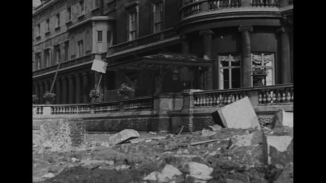 pan damage done to buckingham palace by a german bomb during world war ii / british prime minister winston churchill walks briskly in street /... - buckingham stock videos & royalty-free footage
