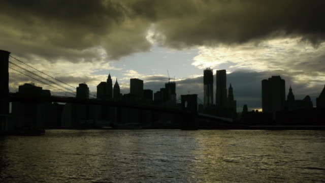 tl pan day new york silhouette with dramatic sky. - spoonfilm stock-videos und b-roll-filmmaterial