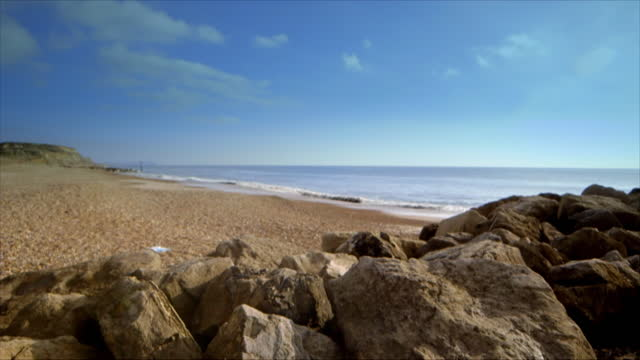 pan defocussed beach in dorset, uk - fade in video transition stock videos & royalty-free footage