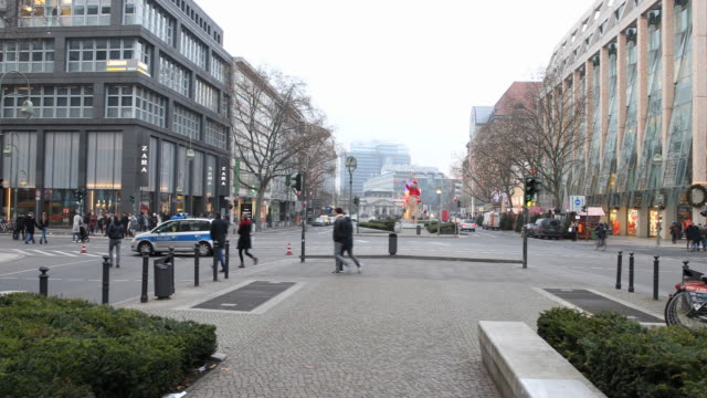 Pan direction Kaufhaus of the Westen a police locks the street to prevent access to the Breitscheidplatz where the assassination took place in Berlin...