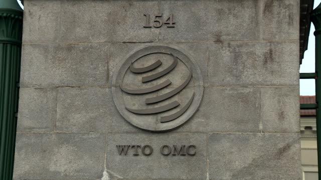 Pan down a stone gate post at the World Trade Organisation Geneva