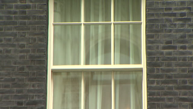 pan down and then pan right on a large single bay window at number 10, downing street - erkerfenster stock-videos und b-roll-filmmaterial