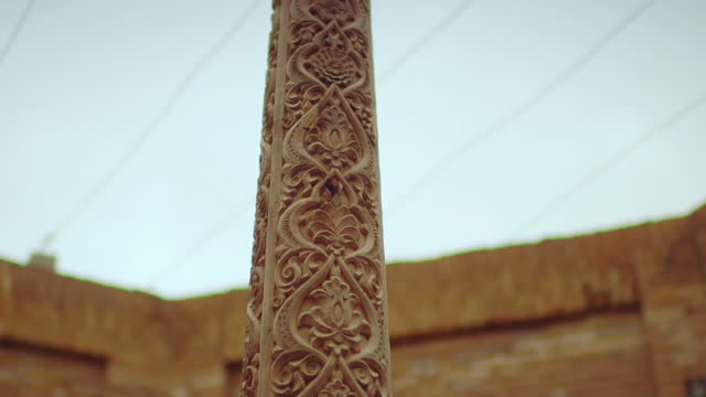 pan down carved wooden pillar, khiva - carving craft product stock videos & royalty-free footage