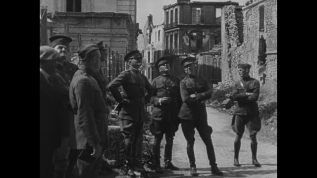 pan down damaged facade of reims cathedral cars and residents walking in front / gen john pershing and other officers examining cathedral's statues... - 1910 1919 stock videos and b-roll footage