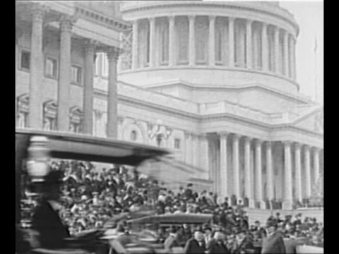 vídeos y material grabado en eventos de stock de pan down ext us capitol to crowd standing on steps in front; traffic passes in foreground / us house speaker frederick h. gillett signs the bill for... - 1910 1919