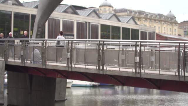 pan down from a pedestrian footbridge onto a canal in bristol, uk - footbridge stock videos & royalty-free footage