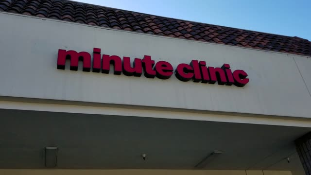 pan down from signage for cvs caremark minute clinic medical clinic sign to entrance of the minute clinic location, san ramon, california, february... - cvs caremark stock videos & royalty-free footage