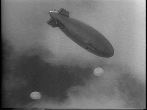 pan down from us navy blimp to crowd of uniformed waves at naval air station in new jersey / waves walk up entrance steps / long shot of waves... - womens army corps stock videos & royalty-free footage