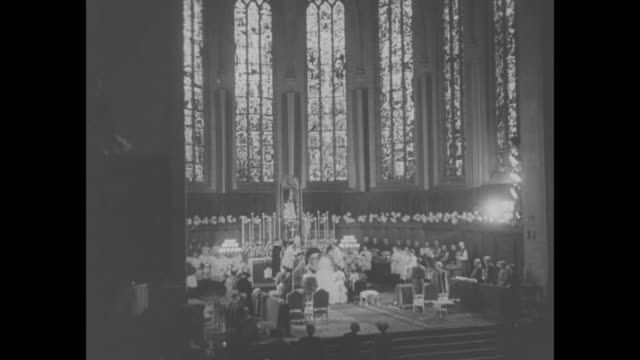 vidéos et rushes de pan down front of notredame cathedral in luxembourg / stained glass windows inside cathedral / groom prince jean of luxembourg and bride princess... - grand duché du luxembourg