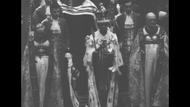pan down int westminster abbey as george vi departs coronation ceremony audience lines both sides of walkway / montage various peers lead procession... - domestic staff stock videos & royalty-free footage