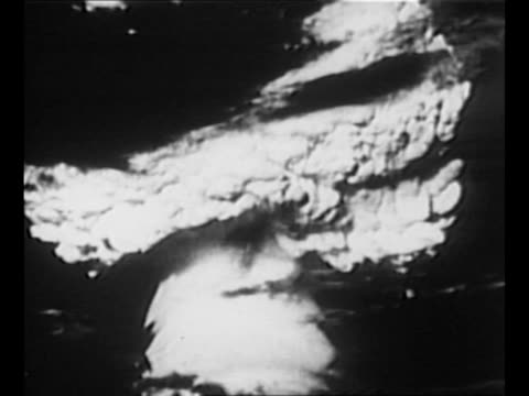 pan down mushroom cloud of castle bravo us's first test of hydrogen bomb / montage japanese fishing boat lucky dragon 5 which was at sea near site of... - radioaktiver niederschlag stock-videos und b-roll-filmmaterial