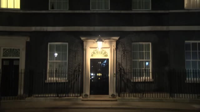 pan down of 10 downing street at night with close up of number 10 on the black door - tilt stock videos & royalty-free footage